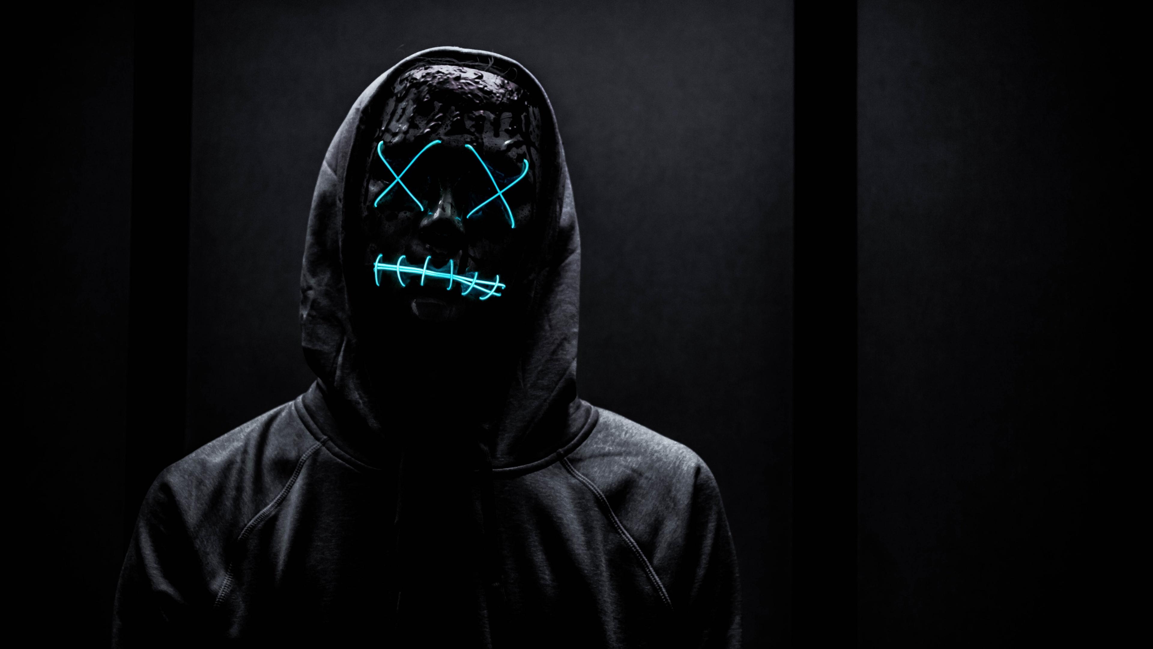 Neon Mask 4k Wallpaper Man In Black Dark Background Hoodie Blue Light 5k Photography 2162