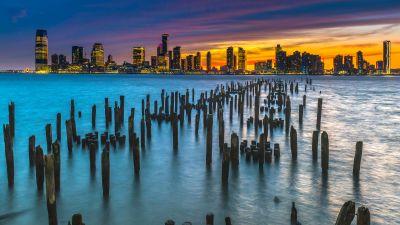 Old Pier Poles, New York City, Skyline, Cityscape, City lights, Dusk, Body of Water, Orange sky, Skyscrapers, Landscape, 5K