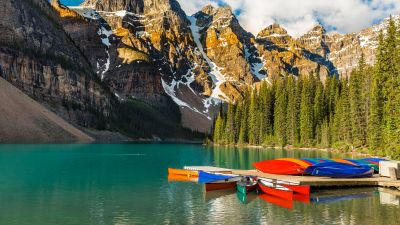 Moraine Lake, Kayak boats, Multicolor, Mountain range, Snow Covered, Day time, Cloudy Sky, Landscape, Scenery, Beautiful, Green Trees, 5K