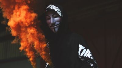 Guy Fawkes mask, Man in Mask, Black Hoodie, Orange Smoke, Dark background, Anonymous, 5K
