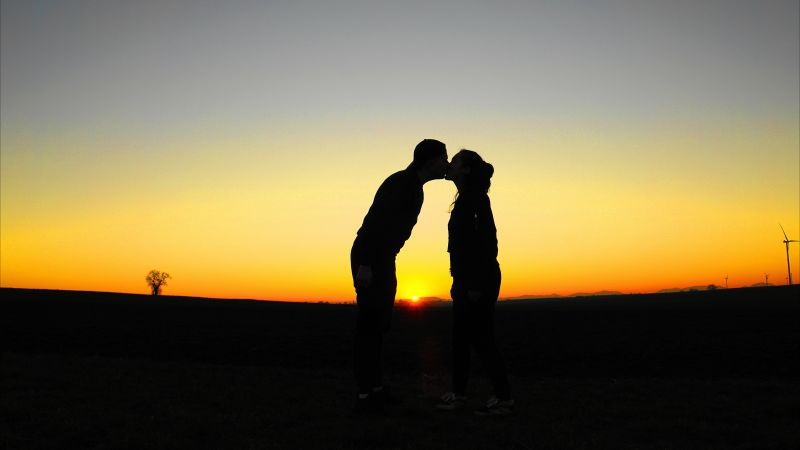 Kissing couple, Silhouette, Romantic, Evening sky, Sunset Orange, Clear sky, Horizon, Together, Lovers, 5K, Wallpaper
