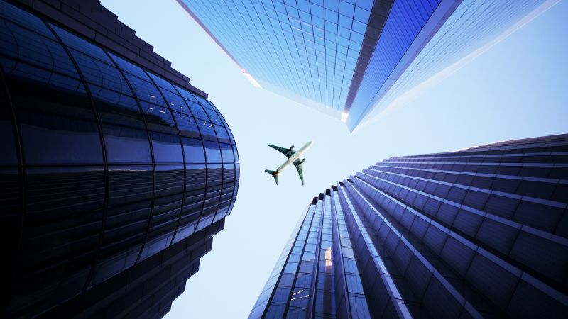 Airplane, Looking up at Sky, Skyscrapers, Daytime, High rise building, Transport aircraft, 5K, Wallpaper